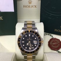 Rolex GMT-Master II Steel and Yellow Gold Black Dial 16713