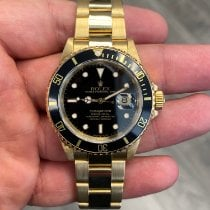 Rolex 16808 Yellow gold 1991 Submariner Date 40mm pre-owned United States of America, California, Beverly Hills
