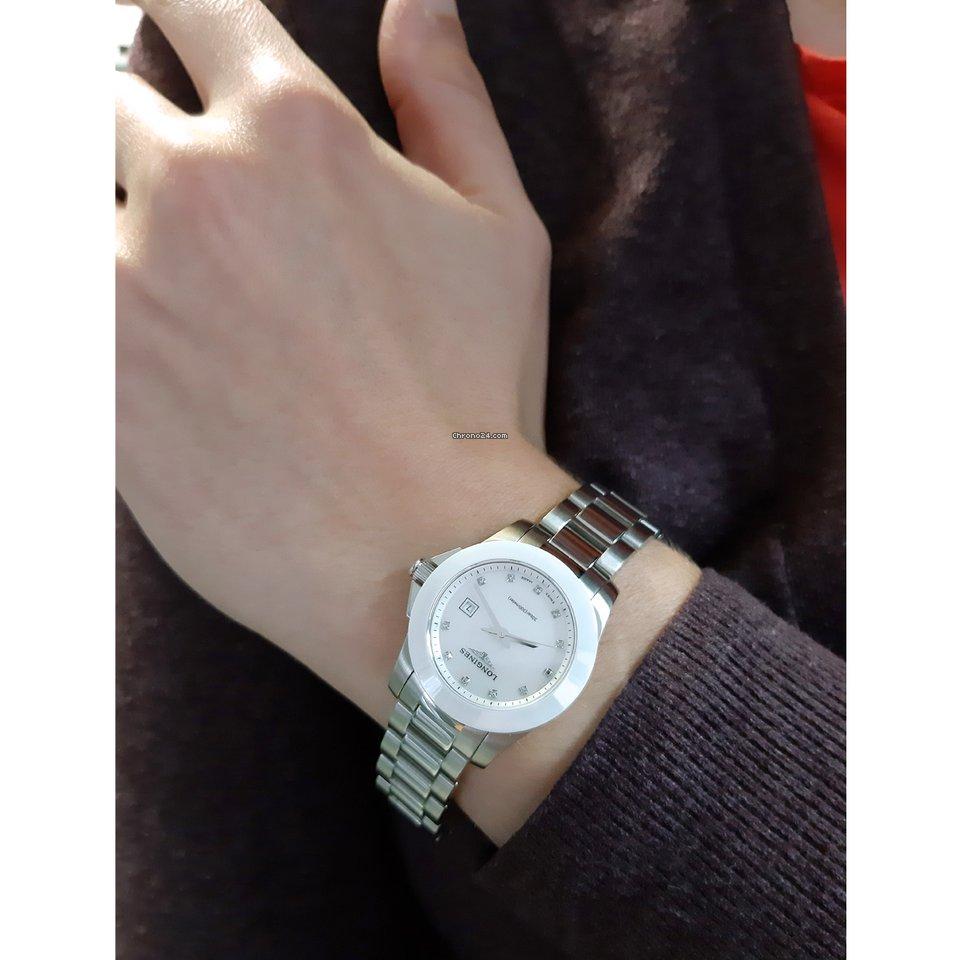 Longines Conquest L3.257.4.87.6 Longines Conquest Quarzo Madreperla Diamanti 29,50mm Ghiera Ceramica Bianca Bracciale Acciaio e Ceramica 2021 new