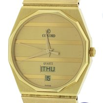 Concord Mariner 14K Yellow Gold 31mm Champagne Quartz Day Date...