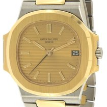 Patek Philippe | Nautilus ref.3800 18kt Yellow Gold and...