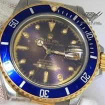 롤렉스 (Rolex) Submariner 18k Gold/Steel Tropical Dial/Blue Bezel...