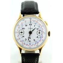 Cyrus . Reloj Cronógrafo. Oro de 18k. Ca. 1945.