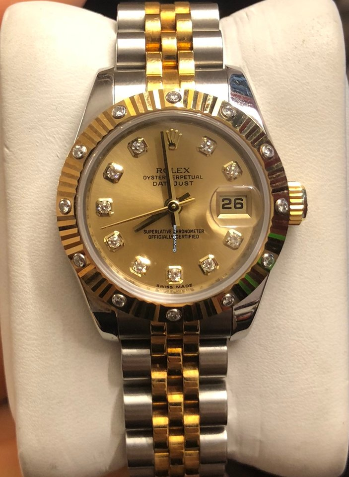 Rolex ladies gold dial with diamonds 179313