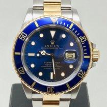 Rolex Submariner Date begagnad 40mm Guld/Stål
