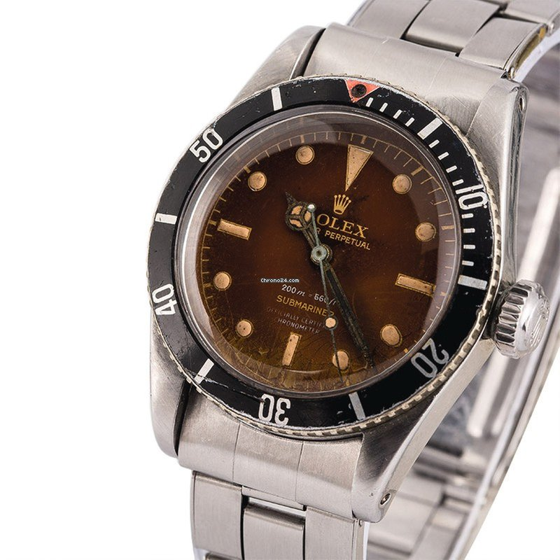 Rolex Submariner Ref 6538 A Stainless Steel Wristwatch With 4 Line Tropical Dial And Bracelet Circa 1958