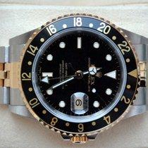 Rolex [near-NOS] GMT Master II Steel & Gold - 2003