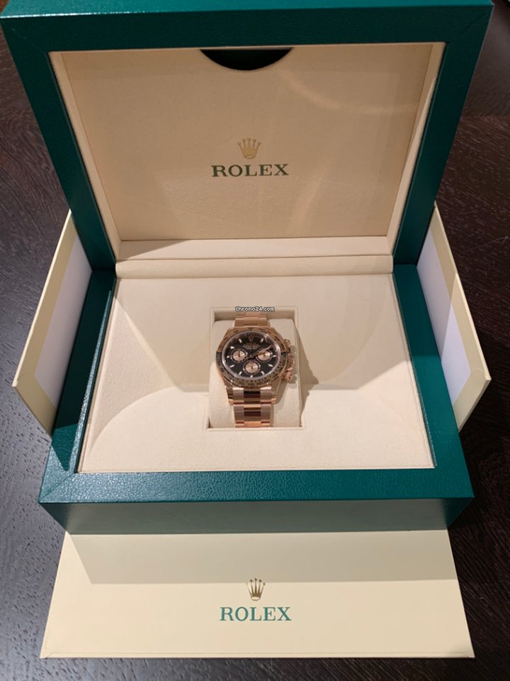 Rolex Cosmograph Rose Gold Daytona (unworn with original box and papers)