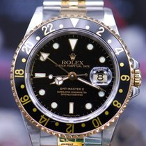 Rolex Oyster Perpetual Gmt-master II Half-gold Black 16713 (mint)