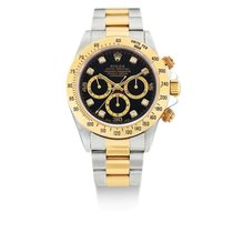 Rolex | A Stainless Steel And Yellow Gold Automatic Chronograp...