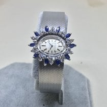 Movado Ladies 18K white gold, diamond and sapphire