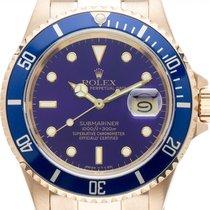 Rolex Gelbgold Automatik Blau 40mm gebraucht Submariner Date