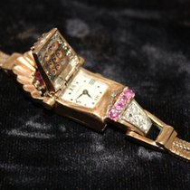 Chalet Orologio in oro giallo, diamanti e rubini