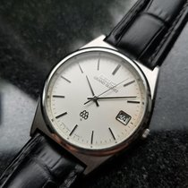 Seiko Men's Elegant Grand Quartz 9942-8000 Dress Watch w/Date...