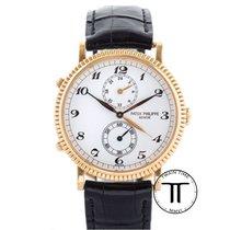 Patek Philippe Travel Time Or jaune 34mm Blanc Arabes