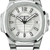 Patek Philippe 7011/1G-001 Nautilus in White Gold - on White...