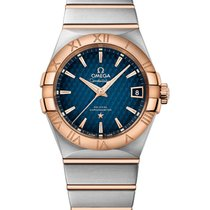 Omega 123.20.38.21.03.001 Or/Acier Constellation Men 38mm nouveau