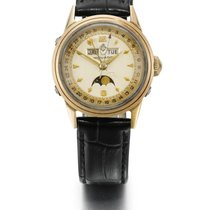 Movado | A Gold Plated And Stainless Steel Triple Calendar...