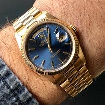 Rolex Day-Date or jaune 18k cadran bleu B/P Série L