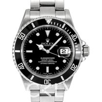 Rolex Submariner Date new Watch with original box and original papers 16610