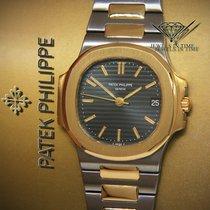Patek Philippe 3800 Nautilus 18k Yellow Gold/Steel Black Dial...